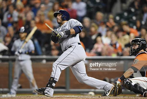 Rene Rivera of the San Diego Padres breaks hit bat hitting a tworun single against the San Francisco Giants in the top of the six inning at ATT Park...