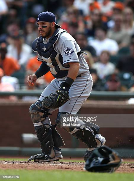 Rene Rivera of the San Diego Padres chases a wild pitch against the San Francisco Giants during the game at ATT Park on Sunday September 28 2014 in...