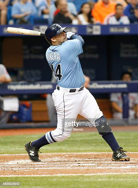 Rene Rivera of the Tampa Bay Rays hits a double off of pitcher Bartolo Colon of the New York Mets during the third inning of a game on August 9 2015...