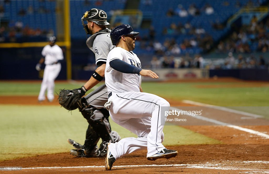 Rene Rivera #44 of the Tampa Bay Rays slides safely home in front of catcher Tyler Flowers #21 of the Chicago White Sox as he scores off of an RBI single by Joey Butler #9 during the sixth inning of a game on June 12, 2015 at Tropicana Field in St. Petersburg, Florida.