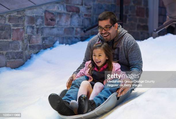 Rene Rodriguez and his stepdaughter Abigail Welle of Santa Ana slide down Olaf's Snow Fest at Disney California Adventure INFORMATION...