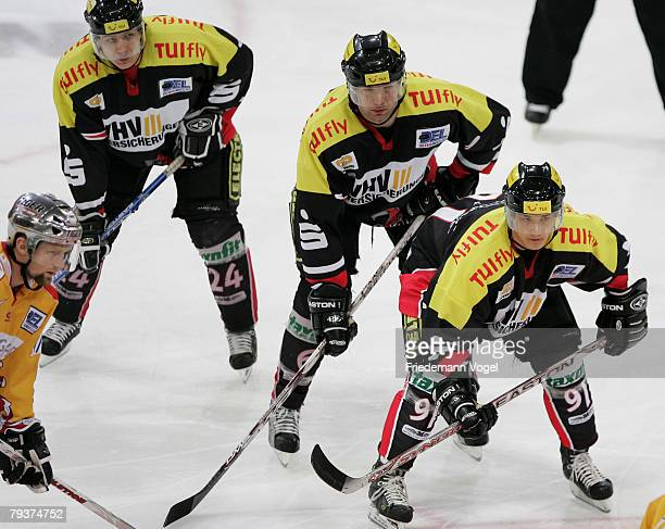Rene Roethke, Aris Brimanis and Marian Dejdar of Hanover looks on during the DEL match between Hannover Scorpions and DEG Metro Stars at the TUI...