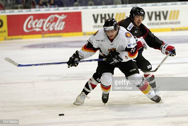 Rene Roethke of Germany and Tetsuya Saito of Japan compete the puck during the EnBW German Nations Cup match between Germany and Japan at the TUI...