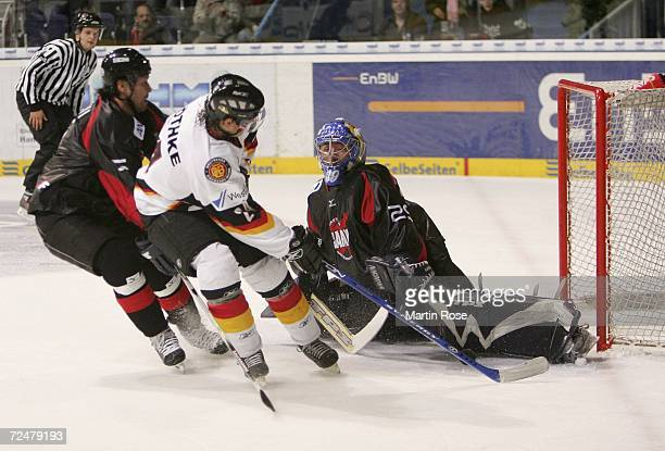 Rene Roethke of Germany tries to score past Naoya Kikuchi of Japan during the EnBW German Nations Cup match between Germany and Japan at the TUI...