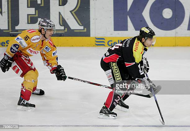 Rene Roethke of Hanover and Patrick Reimer of DEG fight for the puck during the DEL match between Hannover Scorpions and DEG Metro Stars at the TUI...