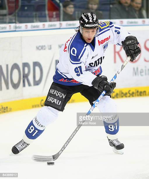 Rene Roethke of Ingolstadt runs with the puck during the DEL Bundesliga game between Hanover Scorpions and ERC Ingolstadt at the TUI Arena on January...