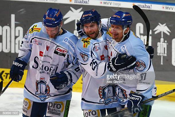 Rene Roethke of Straubing celebrates his team's fifth goal with team mates Alexander Dotzler and Sebastian Osterloh during the DEL match between...