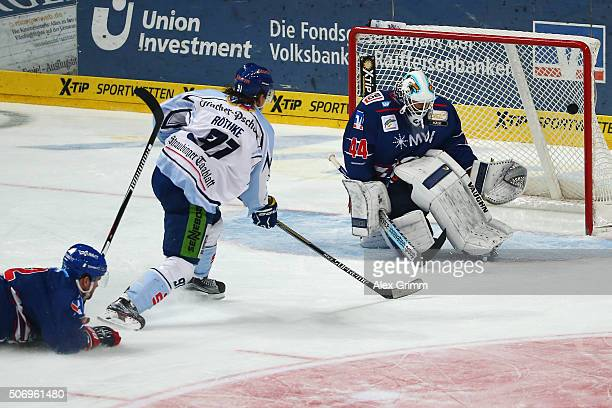 Rene Roethke of Straubing scores his team's fifth goal against goalkeeper Dennis Endras of Mannheim during the DEL match between Adler Mannheim and...