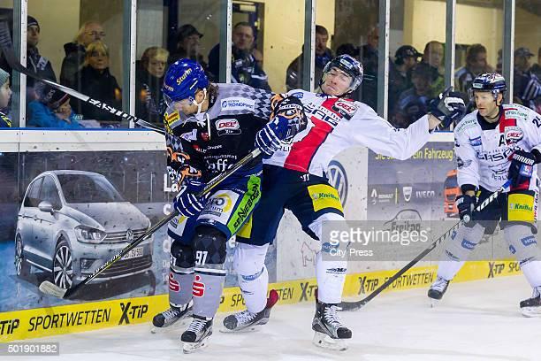 Rene Roethke of Straubing Tigers handles the puck against Marcel Noebels of the Eisbaeren Berlin during the game between the Straubing Tigers and the...
