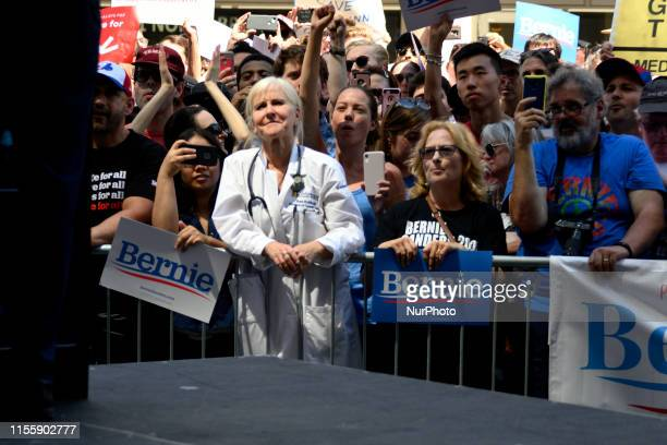 Rene Rubin MD watches Sen Bernie Sanders speak o stage at a rally to protest the imminent closure of Hahnemann University Hospital in Philadelphia PA...