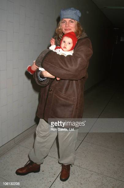 Rene Russo and daughter Rose during Rene Russo Sighting at LAX January 2 1994 at Los Angeles International Airport in Los Angeles California United...