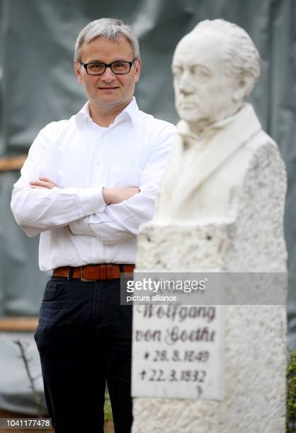 Rene Schmidt director of the historical cure facilities and of the Goethe theatre poses behind a bust of Goethe at the theatre in Bad Lauchstaedt...