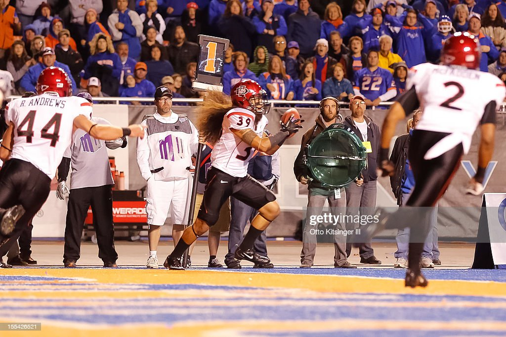 Rene Siluano #39 of the San Diego State Aztecs intercepts a two point conversion attempt by the Boise State Broncos at Bronco Stadium on November 3, 2012 in Boise, Idaho.