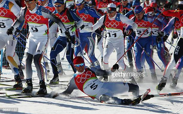 Rene Sommerfeldt of Germany falls over whilst competing in the Mens Cross Country Skiing 30km Pursuit Final on Day 2 of the 2006 Turin Winter Olympic...