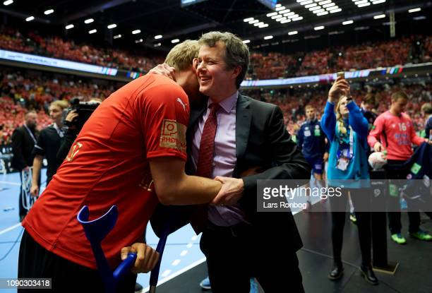 Rene Toft Hansen of Denmark and Crown Prince Frederik of Denmark celebrate as World Champions after the IHF Men's World Championships Handball Final...