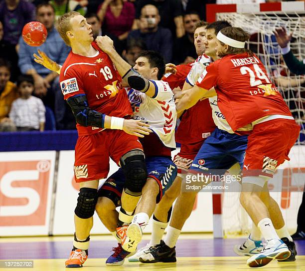 Rene Toft Hansen of Denmark competes with Nenad Vuckovic of Serbia during the Men's European Handball Championship 2012 group A match between Serbia...
