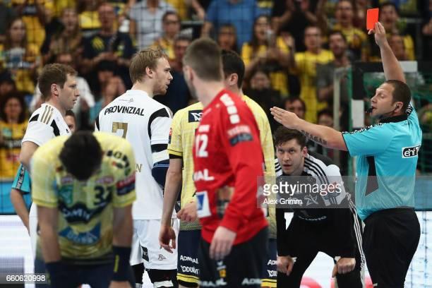 Rene Toft Hansen of Kiel is sent off with a red card during the EHF Champions League Quarter Final Leg 2 match between Rhein Neckar Loewen and THW...