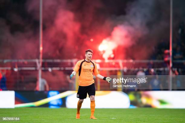Rene Vollath of Uerdingen reacts as supporters of Mannheim light fireworks during the Third League Playoff Leg 2 match between SV Waldhof Mannheim...
