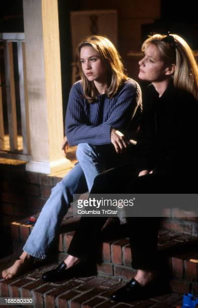 Renée Zellweger and Bonnie Hunt sit on a porch in a scene from the film 'Jerry Maguire' 1996