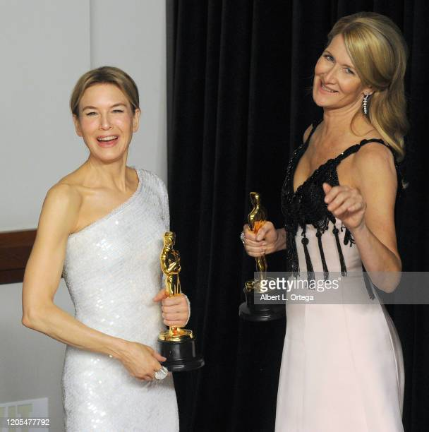 Renée Zellweger and Laura Dern pose inside The Press Room of the 92nd Annual Academy Awards held at Hollywood and Highland on February 9, 2020 in...