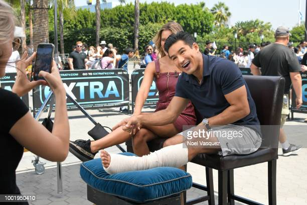 Renee Bargh and Mario Lopez visit 'Extra' at Universal Studios Hollywood on July 19 2018 in Universal City California