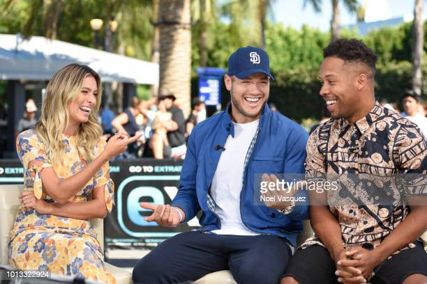 """Renee Bargh, Colton Underwood and Wills Reid visit """"Extra"""" at Universal Studios Hollywood on August 8, 2018 in Universal City, California."""