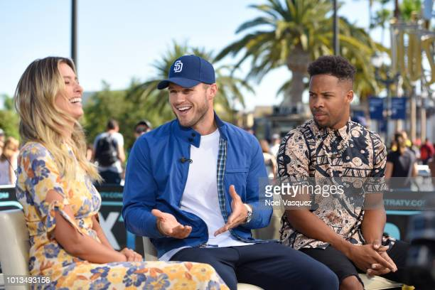 Renee Bargh Colton Underwood and Wills Reid visit Extra at Universal Studios Hollywood on August 8 2018 in Universal City California