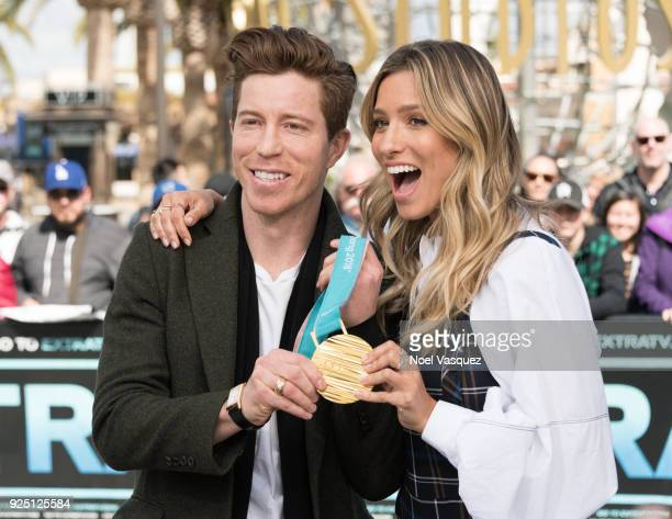 Renee Bargh holds Shaun White's gold medal at 'Extra' at Universal Studios Hollywood on February 27 2018 in Universal City California