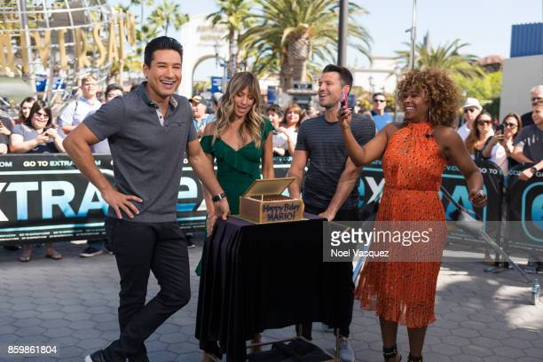 Renee Bargh Mark Wright and Tanika Ray sing Happy Birthday to Mario Lopez at 'Extra' at Universal Studios Hollywood on October 10 2017 in Universal...