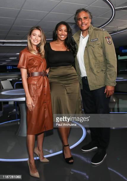 Renee Bargh Sasha Gabriella Fox and Rick Fox on the set of Extra at Burbank Studios on November 12 2019 in Burbank California