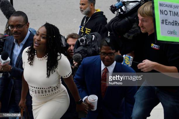 Renee Benson and Andrew Wyatt spokesperson for Bill Cosby on the steps of Montgomery County Court House as Bill Cosby appears before Judge Steven...