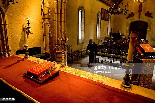 Renee DeBruin of Milwaukee Wisconsin prays for the ailing Pope John Paul II April 2005 at the St Joan of Arc Chapel on the Marquette University...