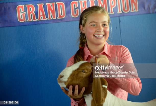 Renee Eisele with the Rinn Valley 4H Club poses with 'Fred' for photos at the Boulder County Fair Wednesday August 07 2013 after they won the Grand...