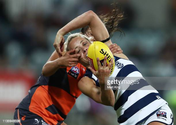 Renee Garing of the Cats is challenged by Rebecca Beeson of the Giants during the AFL round seven match between the Greater Western Sydney Giants and...