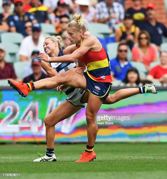 Renee Garing of the Cats tackles Erin Phillips of the Adelaide Crows after she kicks the ball during the AFLW Preliminary Final match between the...