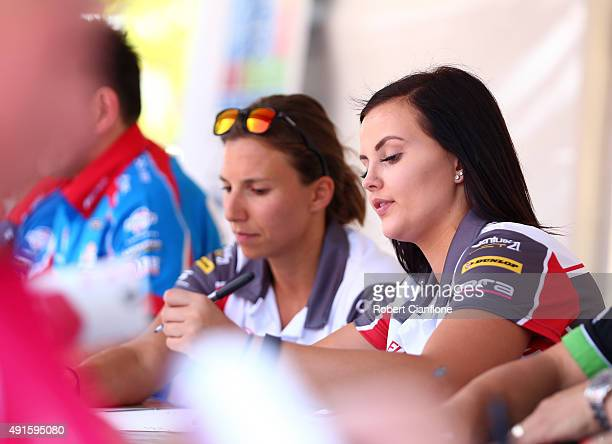 Renee Gracie and Simona De Silvestro of Harvey Norman Supergirls Falcon sign autographs ahead of the Bathurst 1000 which is race 25 of the V8...