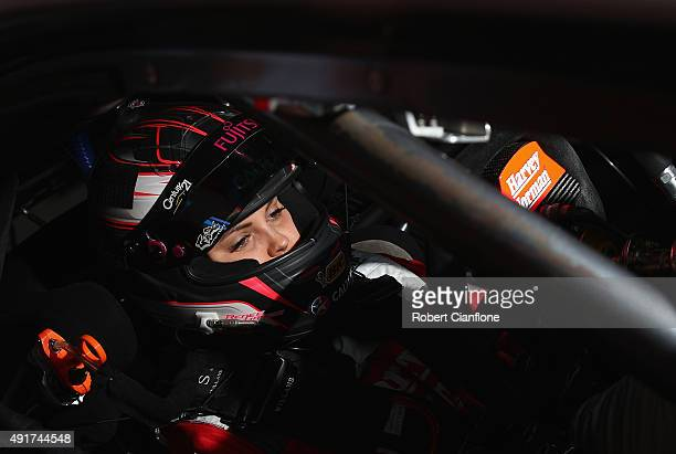 Renee Gracie driver of Harvey Norman Supergirls Falcon prepares for practice for the Bathurst 1000 which is race 25 of the V8 Supercars Championship...