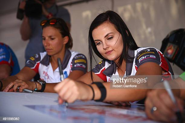 Renee Gracie driver of Harvey Norman Supergirls Falcon signs autographs ahead of the Bathurst 1000 which is race 25 of the V8 Supercars Championship...