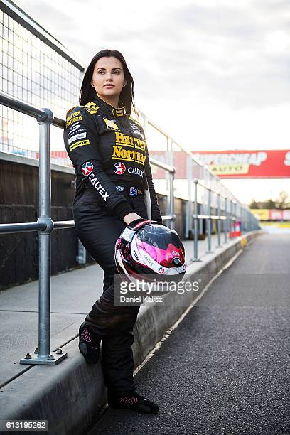 Renee Gracie driver of the Harvey Norman Super Girls Nissan Altima poses for a photo prior to practice for the Bathurst 1000 which is race 21 of the...