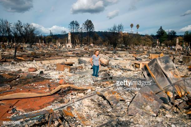 Renee Johnson stands in the middle of her burned home in the Coffey Park area of Santa Rosa California on October 20 2017 Residents are being allowed...