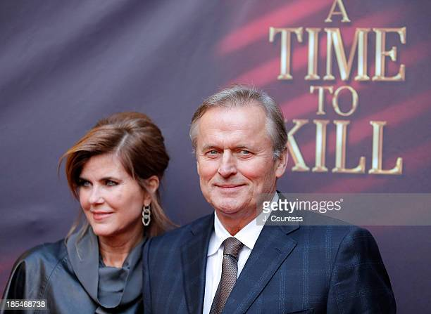 """Renee Jones and author John Grisham attend the Broadway opening night of """"A Time To Kill"""" at The Golden Theatre on October 20, 2013 in New York City."""