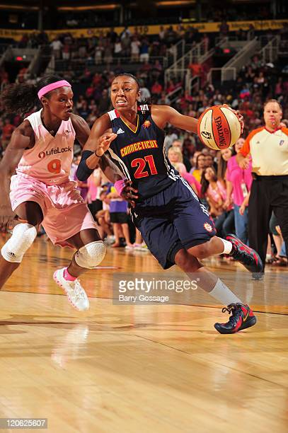 Renee Montgomery of the Connecticut Sun drives against Marie FerdinandHarris of the Phoenix Mercury on August 7 2011 at US Airways Center in Phoenix...