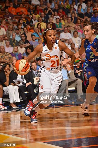 Renee Montgomery of the Connecticut Sun drives to the basket against Kelly Miller of the New York Liberty during the game on May 20 2012 at the...