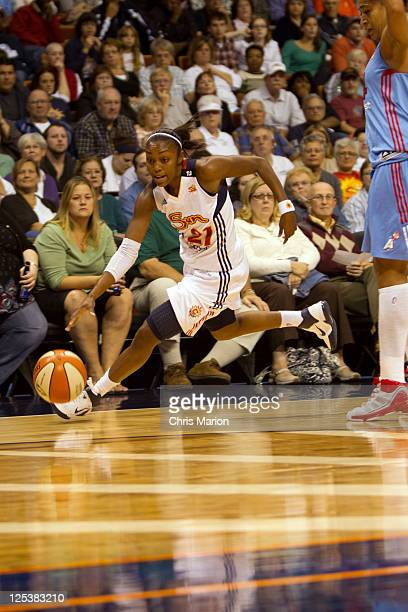 Renee Montgomery of the Connecticut Sun works along the sideline against the Atlanta Dream in Game One of the Eastern Conference Semifinals during...