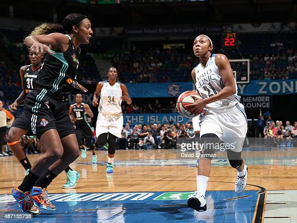 Renee Montgomery of the Minnesota Lynx drives to the basket against Candice Wiggins of the New York Liberty on September 6 2015 at Target Center in...