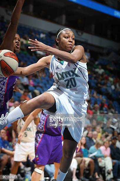 Renee Montgomery of the Minnesota Lynx goes for the rebound against Rebekkah Brunson of the Sacramento Monarchs during the game on August 28 2009 at...