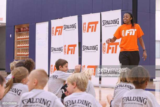 Renee Montgomery of the Minnesota Lynx interacts with young fans during a WNBA FIT Clinic at The Courts at Mayo Clinic Square on August 14 2017 in...