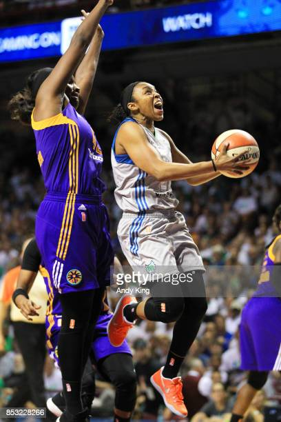 Renee Montgomery of the Minnesota Lynx shoots around Jantel Lavender of the Los Angeles Sparks during the third quarter of Game One of the WNBA...
