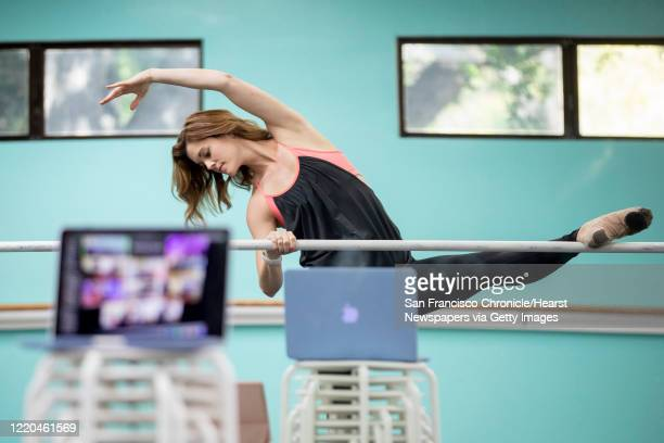 Renee Moran, co-owner of the children performing arts center Performing Academy, practices moves and curriculum for her virtual dance class while at...
