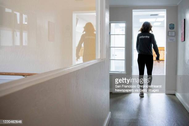 Renee Moran, co-owner of the children performing arts center Performing Academy, walks through her empty dance studio in Pleasant Hill, Calif....